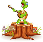 Cartoon turtle playing a guitar on tree stump