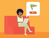 Cartoon woman sitting on sofa online shopping for hairdryer