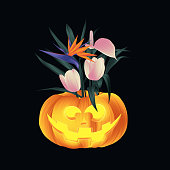 Carved Halloween pumpkin head jack lantern decorated with palm leaves, Bird of paradise and tulip flowers