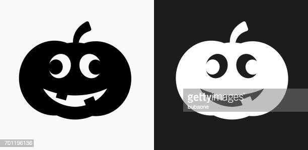 Carved Halloween Pumpkin Icon on Black and White Vector Backgrounds