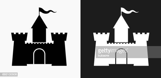 castle icon on black and white vector backgrounds - castle stock illustrations, clip art, cartoons, & icons