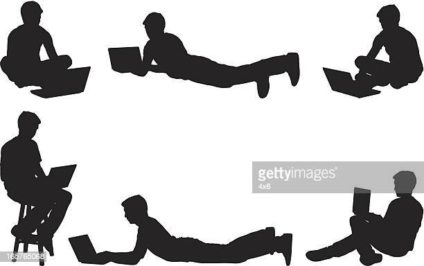 casual man with laptop computer - lying on front stock illustrations, clip art, cartoons, & icons