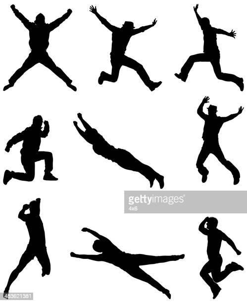 Casual men jumping through the air