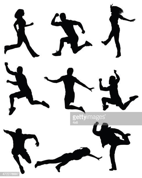 Casual people jumping mid air