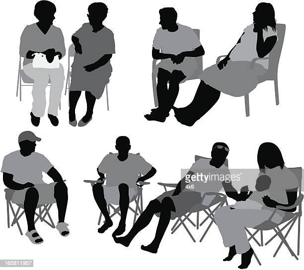 Casual people sitting on chairs