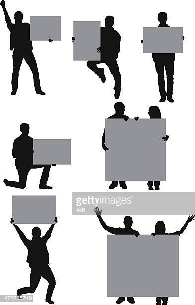 casual people with placards - holding up sign stock illustrations