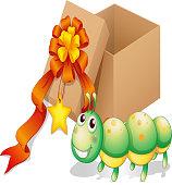 caterpillar toy beside a box