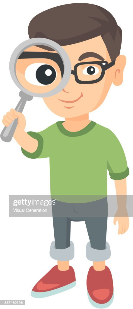 Caucasian boy looking through a magnifying glass