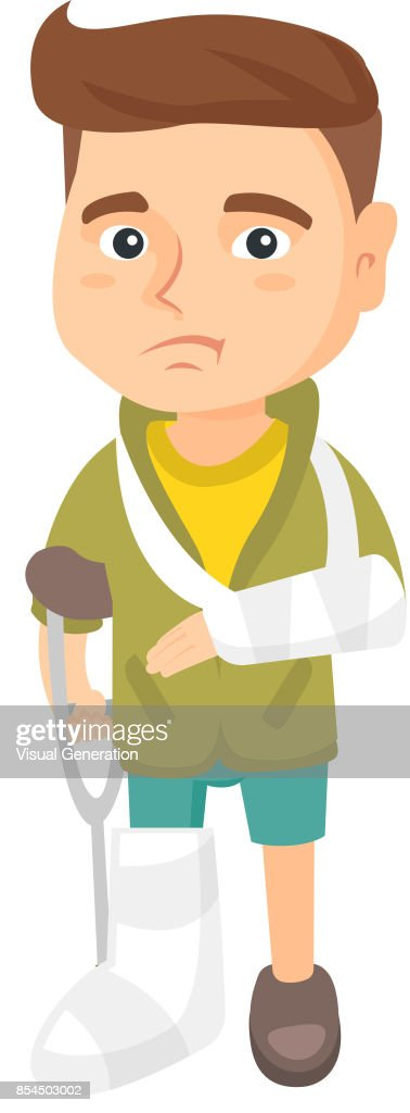 Caucasian sad injured boy with broken arm and leg