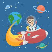 Caucasian smiling boy riding a spaceship