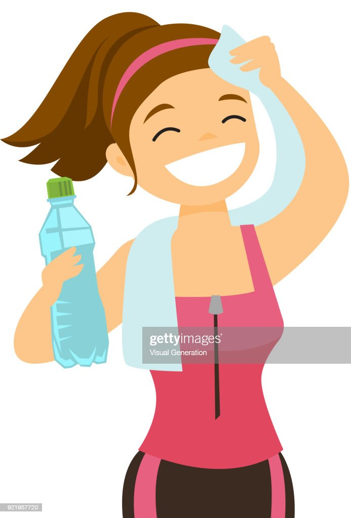 Caucasian sportswoman wiping sweat with a towel