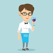 Caucasian waitress holding a glass of wine