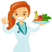 Caucasian white dietician offering healthy food