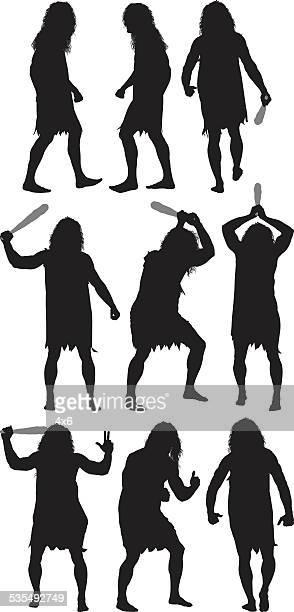 caveman in various actions - caveman stock illustrations