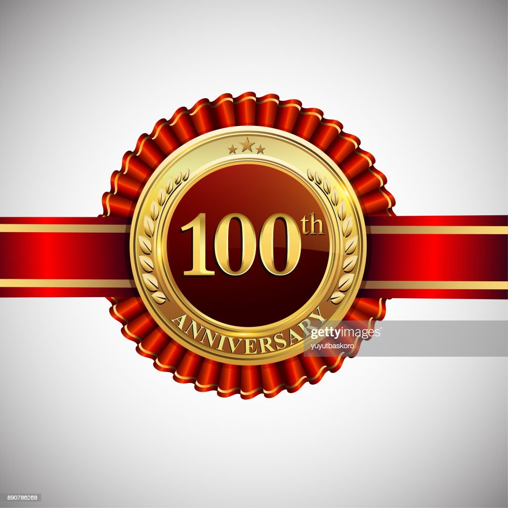 Celebrating 100th anniversary symbol, with golden badge and red ribbon isolated on white background.