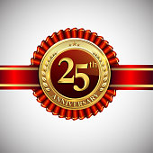 Celebrating 25th anniversary symbol, with golden badge and red ribbon isolated on white background.