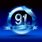 Celebrating 91st anniversary Design, with silver ring and blue ribbon isolated on blue black background.