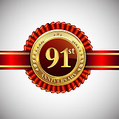 Celebrating 91st anniversary symbol, with golden badge and red ribbon isolated on white background.
