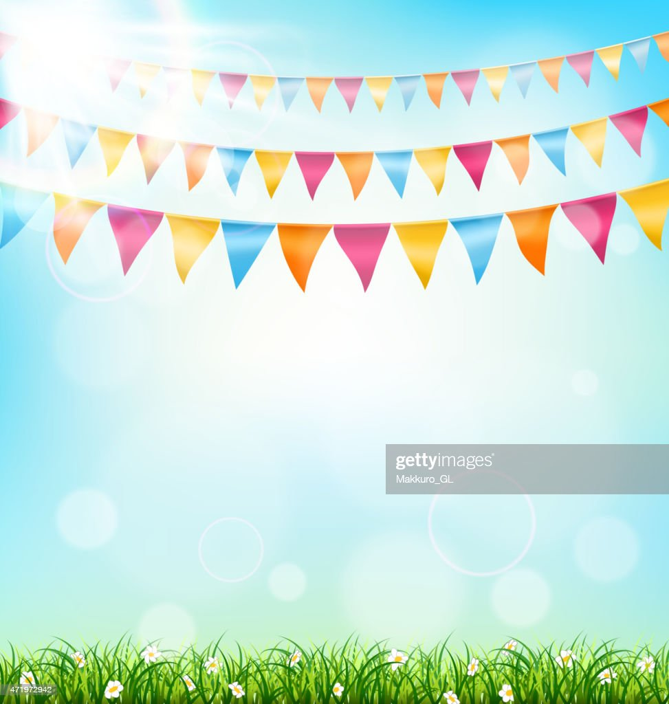 Celebration background with buntings grass and sunlight on sky