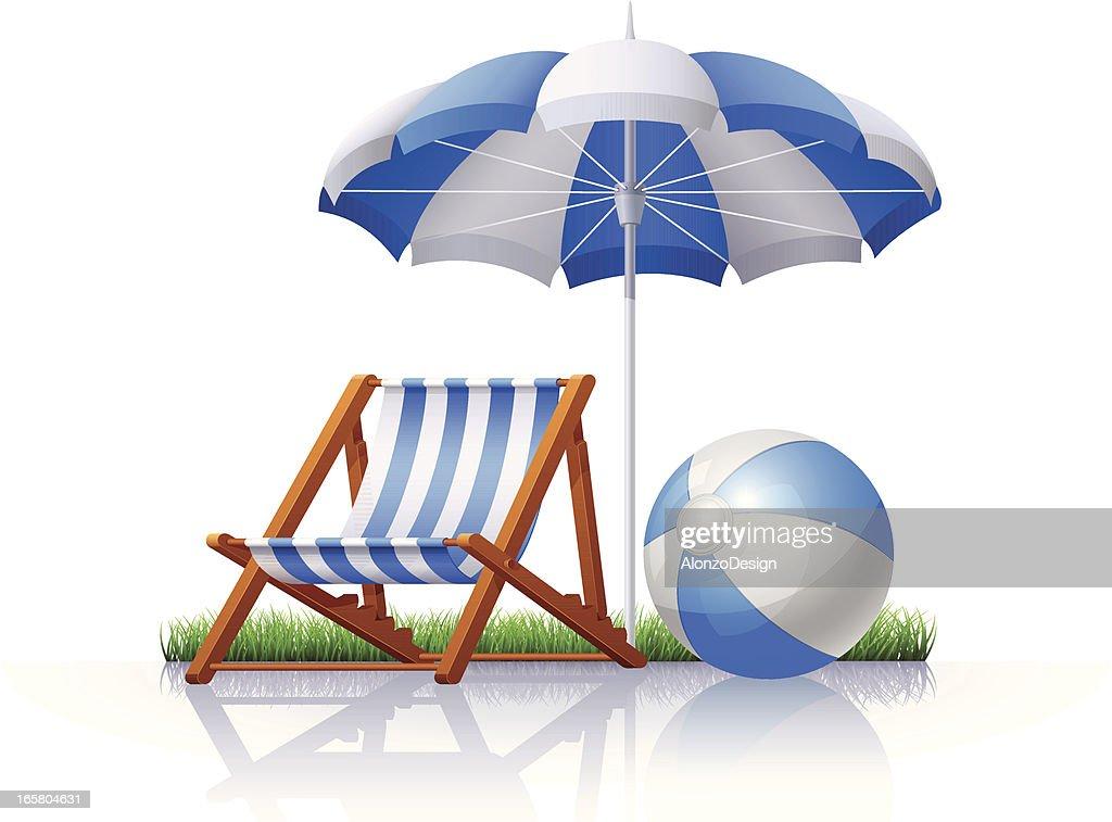 Chair, umbrella and beach ball