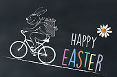 chalk drawing of cycling easter bunny on chalk board