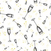 Champagne glass with bublles and splashes. Hand drawn isolated vector seamless pattern.