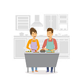cheerful couple cooking dinner, prepearing food together at home