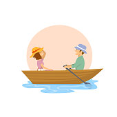 cheerful cute couple having a romantic trip on a rowing boat