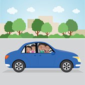Cheerful family driving in a car