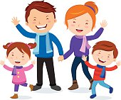 Cheerful family in winter outfits.