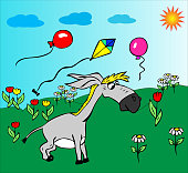 cheerful little gray donkey walks on a green meadow