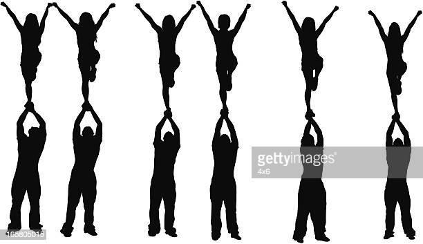 cheerleaders - cheerleader stock illustrations