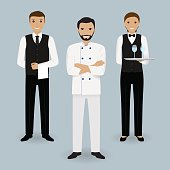 Chef cook and two waiters in uniform standing together. Restaurant people characters.