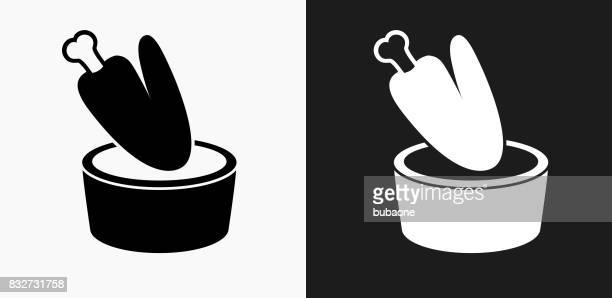 chicken wing and dip icon on black and white vector backgrounds - dipping stock illustrations, clip art, cartoons, & icons