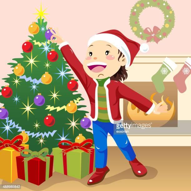 Child decorating christmas tree