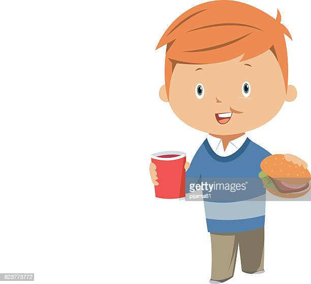 Child eating hamburger and soda