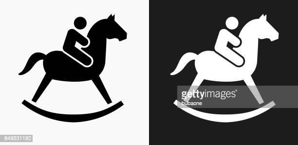 Child on a Toy Horse Icon on Black and White Vector Backgrounds