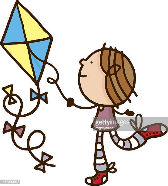 Child playing with a kite
