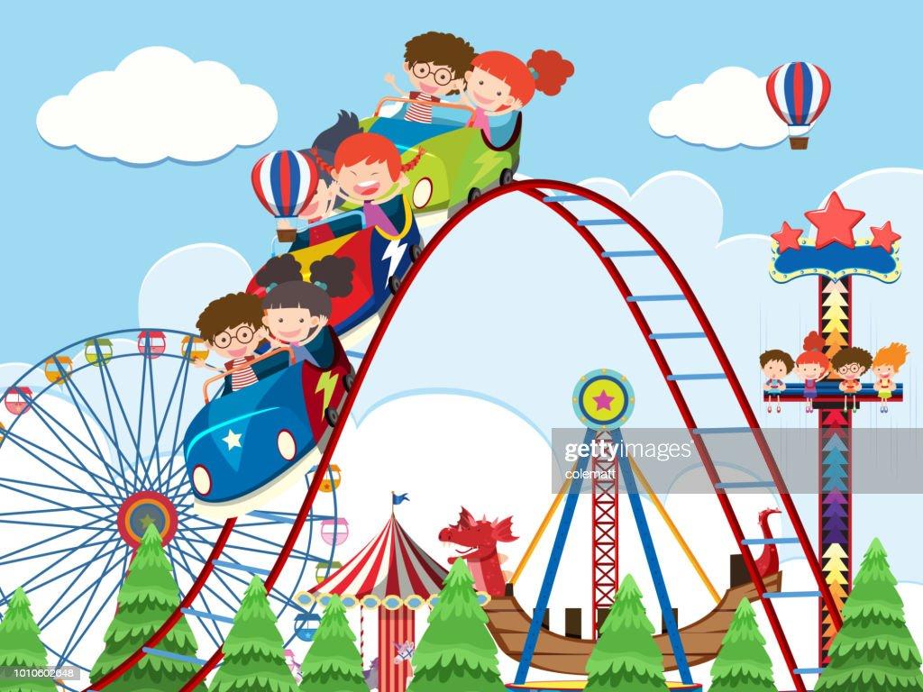 Children and rides at amusement park