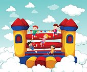 Children bouncing on rubber house