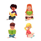 Children, boys and girls, reading interesting book sitting on floor