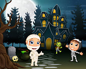 Children celebrate a halloween party outdoors at night