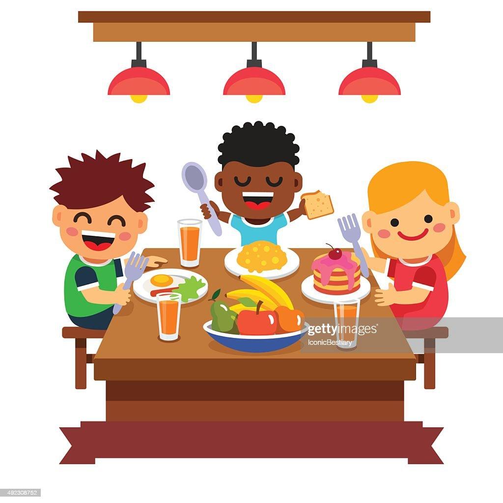 Children having dinner at the kindergarten of home