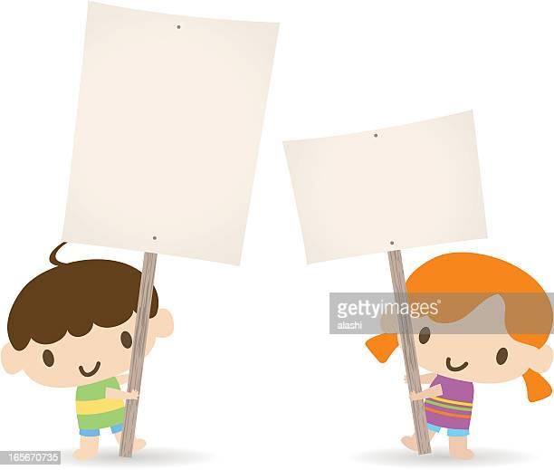 Children holding a blank sign for your message(Boy and Girl)