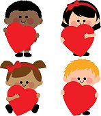 Children holding red hearts