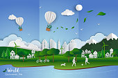 Childs playing soccer with white clean city on paper art scene abstract background