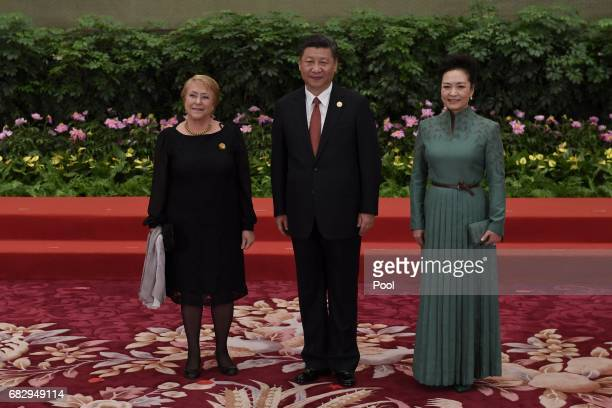 Chile's President Michelle Bachelet pose with Chinese President Xi Jinping and his wife Peng Liyuan during a welcome ceremony for leaders attending...