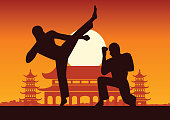 Chinese Boxing Kung Fu martial art famous sport,two boxer fight together around with Chinese temple