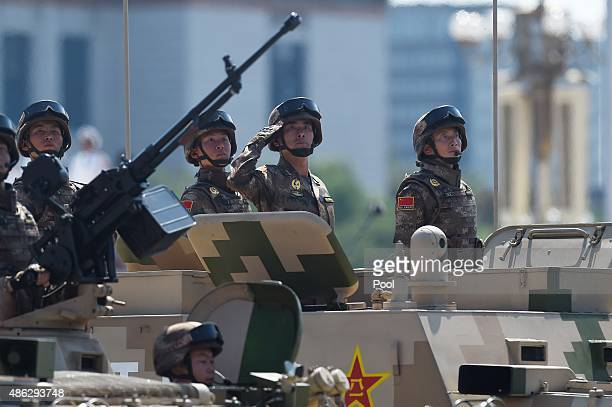 Chinese military vehicles are paraded through Tiananmen Square during a military parade to mark the 70th anniversary of the end of World War Two on...