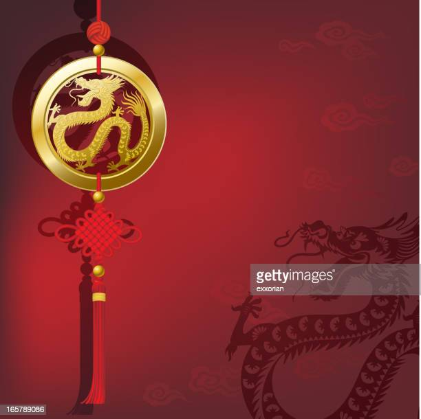 chinese new year dragon lucky coin with knot - chinese dragon stock illustrations